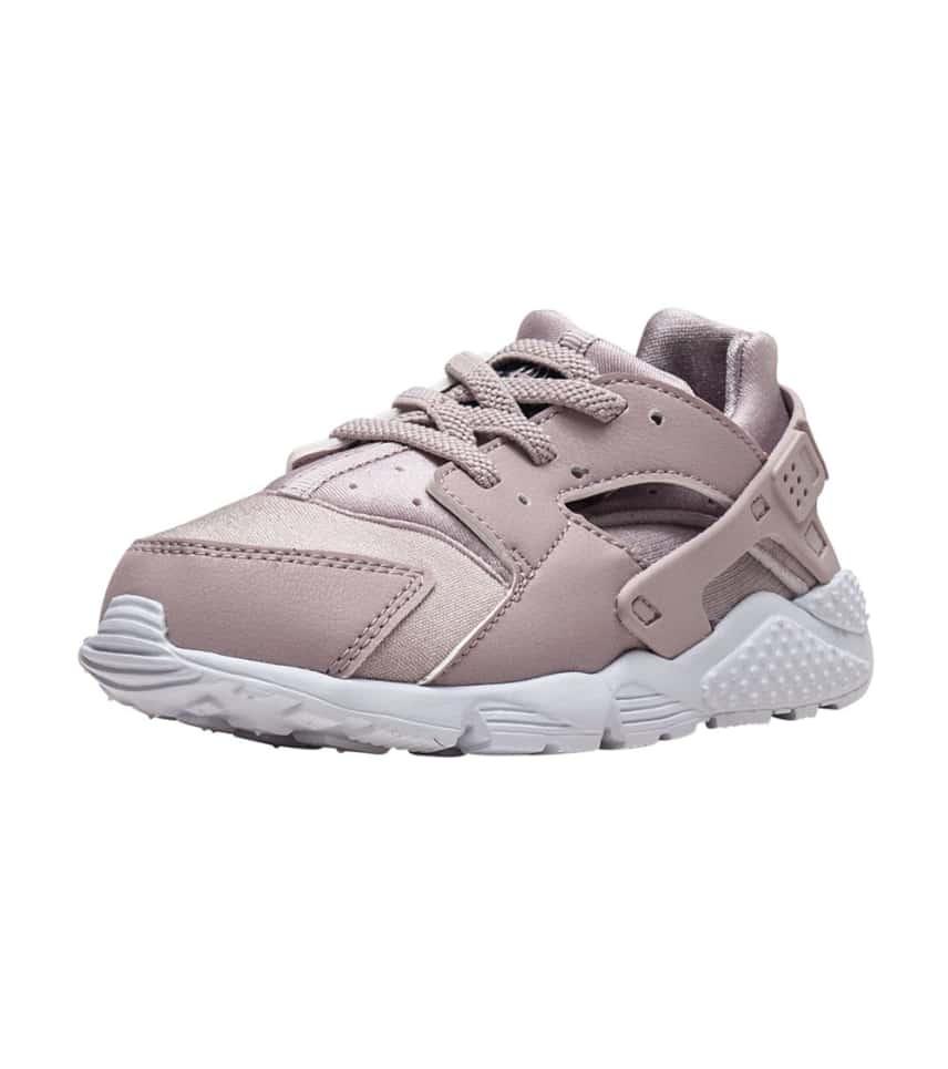 66e6680484ad Nike HUARACHE RUN SNEAKER (Medium Pink) - 704952-603