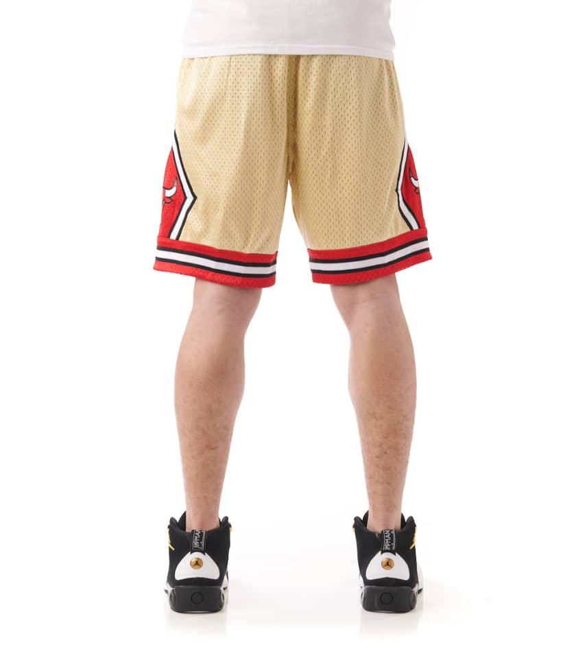 e48575d1450ff4 Mitchell and Ness Chicago Bulls Swingman Shorts (Gold ...